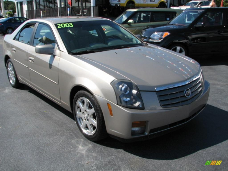 Gold 2003 Cadillac CTS 4 DR with BEIGE LEATHER seats