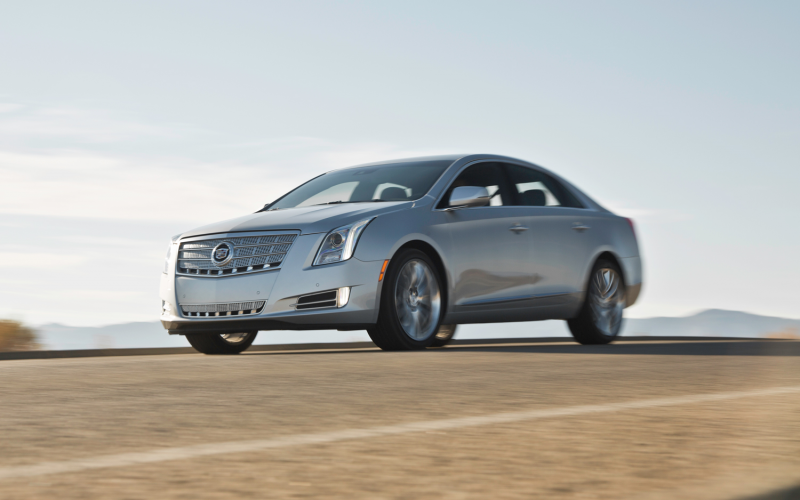 2013 Cadillac Xts 4 Platinum Front Three Quarters In Motion