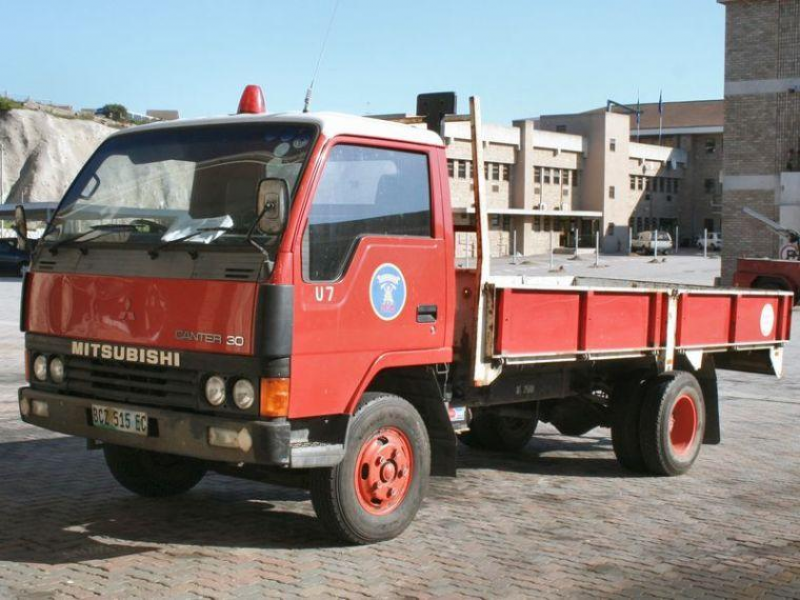 Front Left Red Mitsubishi Canter 30 Truck Picture