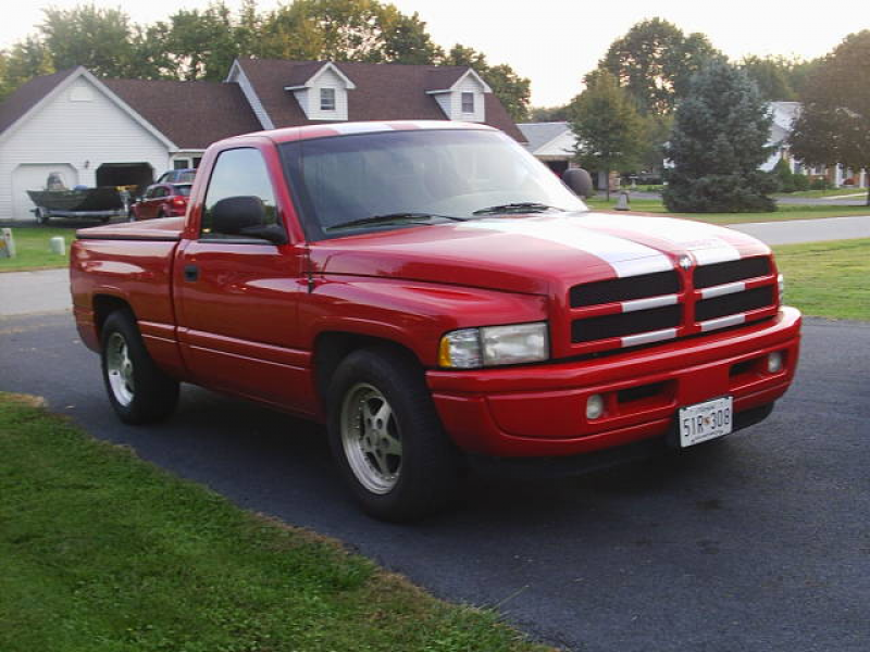 1998 Dodge Ram SS/T Flame Red/Silver, 5.9L V8, auto. 89,XXX miles.