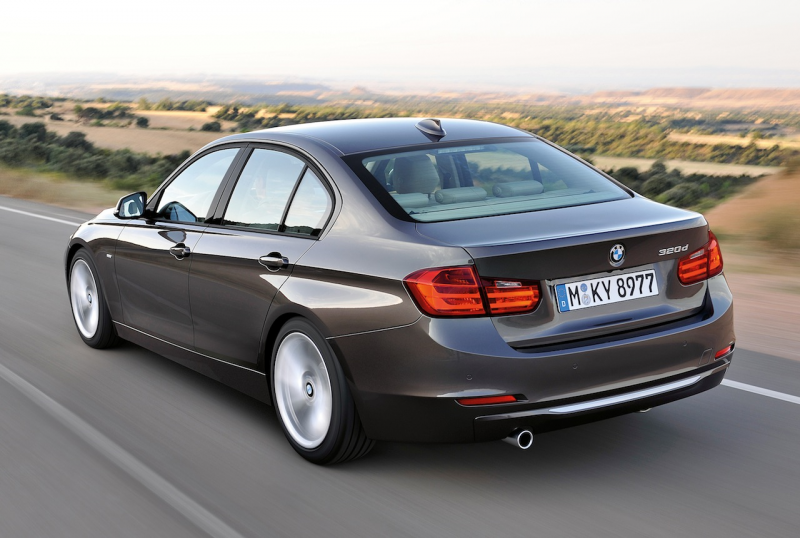 2012 BMW 3 Series Modern Line Rear 3/4 View (Action)