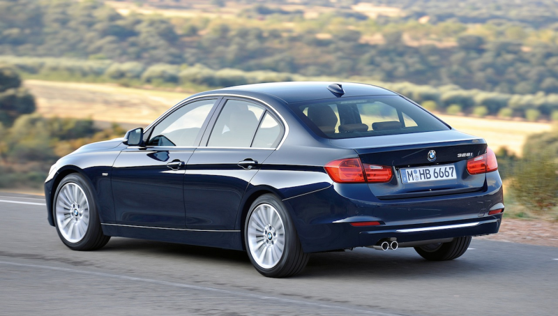 2012 BMW 3 Series Luxury Line Rear 3/4 View (Action)