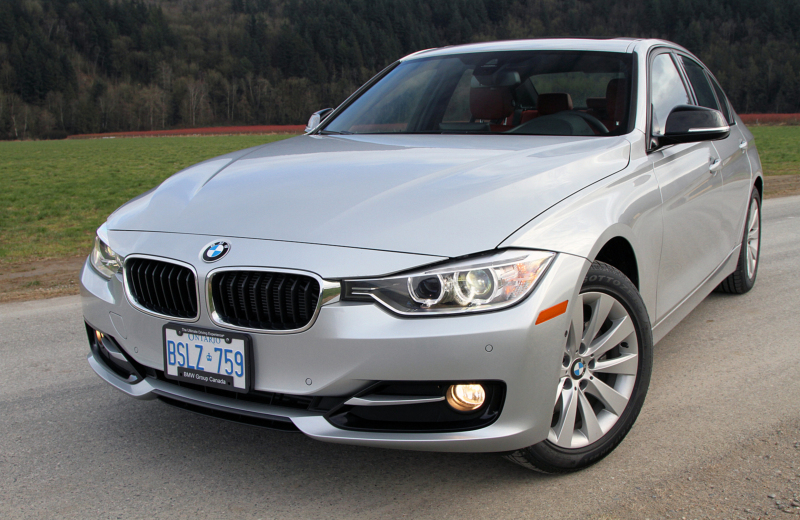 The BMW 328d features Bi-Xenon headlights, a sculpted hood and fenders ...