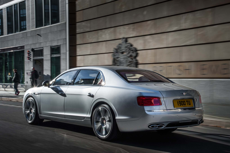 2015 Bentley Flying Spur V8 rear three quarters in motion