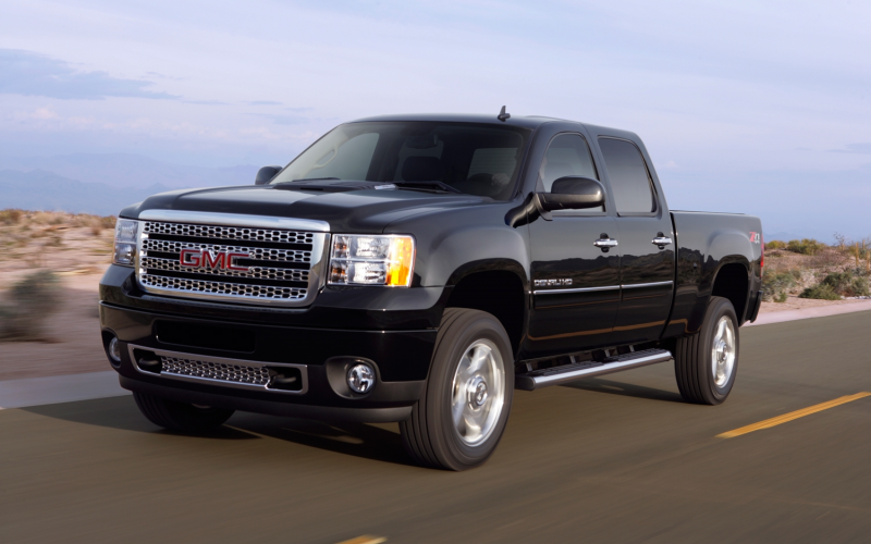 2012 GMC Sierra 2500HD front three quarters in motion