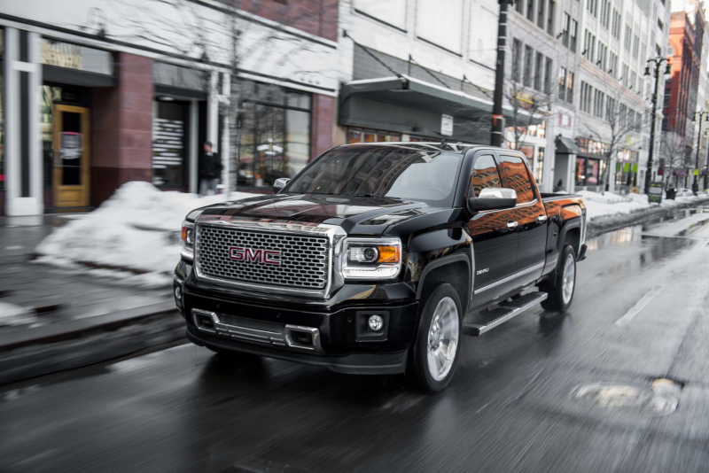 2014 Gmc Sierra Denali 1500 Crew Cab Front Three Quarters In Motion 03